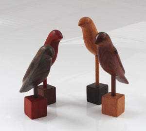 Handcarved set of 4 Wooden Birds -  on pedestal  each bird 15 x 10 x 3.5 cm