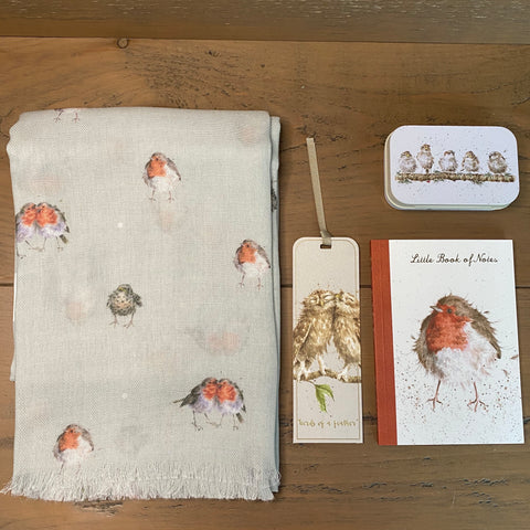 Wrendale Designs Bird themed letterbox gift comprising a robin scarf, owl bookmark, robin notebook and a little tin with a row of birds on it.