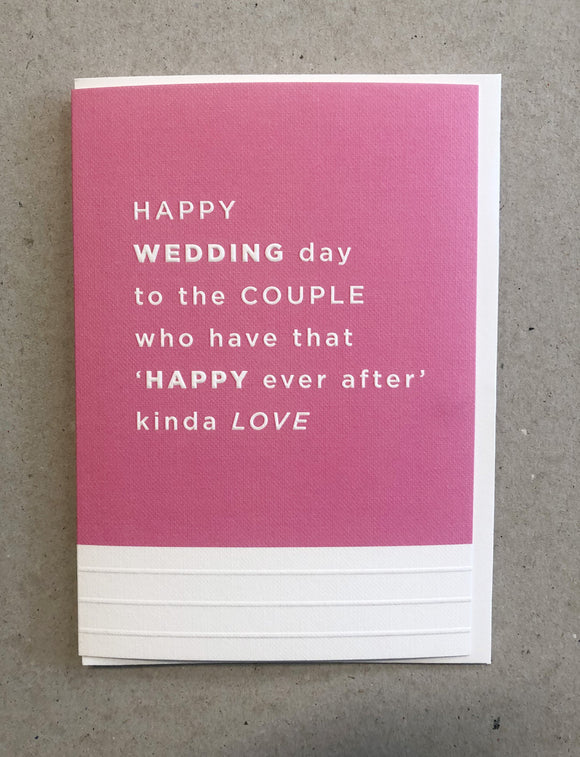 A greeting card. The top three quarters is printed in a fuchsia pink. Text in this area says 'Happy Wedding day to the couple who have that Happy ever after kinda love'. The text is white and embossed. The bottom of the quarter of the card is unprinted and white. It has 3 horizontal, embossed narrow lines.