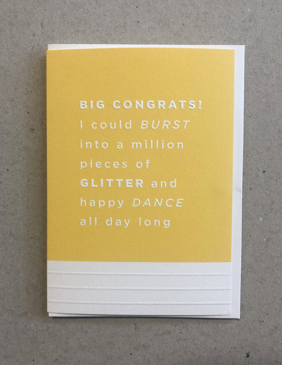 A greeting card. The top three quarters is printed in a pineapple yellow. Text in this area says 'Big Congrats! I could burst into a million pieces of glitter and happy dance all day long'. The text is white and embossed. The bottom of the quarter of the card is unprinted and white. It has 3 horizontal, embossed narrow lines.