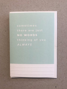 A greeting card. The top three quarters is printed in a light blue. Text in this area says 'sometimes there are just no words thinking of you always'. The text is white and embossed. The bottom of the quarter of the card is unprinted and white. It has 3 horizontal, embossed narrow lines.
