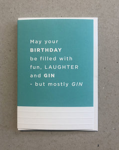 A greeting card. The top three quarters is printed in a turquoise. Text in this area says 'May your birthday be filled with fun, laughter and Gin - but mostly Gin'. The text is white and embossed. The bottom of the quarter of the card is unprinted and white. It has 3 horizontal, embossed narrow lines.