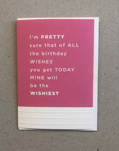 A greeting card. The top three quarters is printed in a fuchsia pink. Text in this area says 'I'm pretty sure that of all the birthday wishes you get today, mine will be the wishiest'. The text is white and embossed. The bottom of the quarter of the card is unprinted and white. It has 3 horizontal, embossed narrow lines.