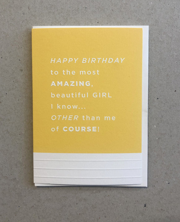A greeting card. The top three quarters is printed in a pineapple yellow. Text in this area says 'Happy Birthday to the most amazing, beautiful Girl I know .... Other than me of course'. The text is white and embossed. The bottom of the quarter of the card is unprinted and white. It has 3 horizontal, embossed narrow lines.
