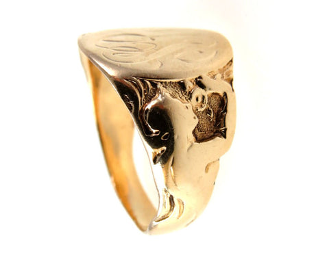 Art Nouveau gold signet ring, sides carved as a beautiful woman enjoying the scent of flowers.