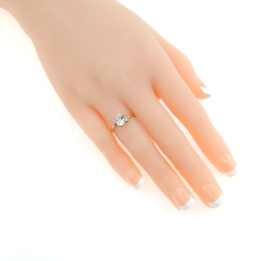 White Topaz Gold Angled Setting Ring