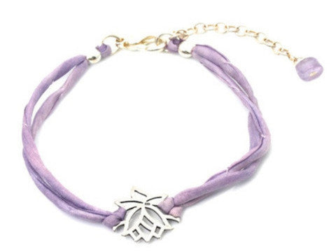 Lotus on silk cord - sterling silver