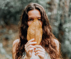 Woman With Dry-skin Holding Dry Leaf In Her Hand