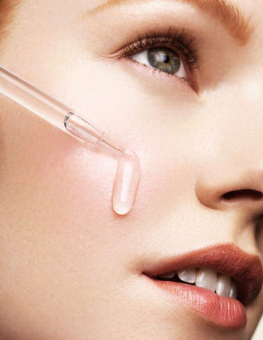 Woman Face With Dropper In Hand Dot and Key has The Best Hyaluronic Serum In India