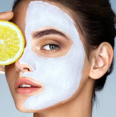 Lady with face pack and lemon