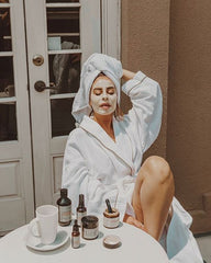 Lady with Skincare Products Relaxing and De-stressing