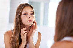 Woman Checking Her Face Skin By Touching With Hands