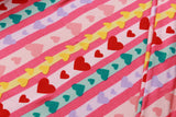 "Rainbow Hearts on Pink, Brushed Jersey 60"" Wide"
