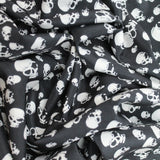 "Polyester Peachskin 'Angry Skulls' 60"" wide"