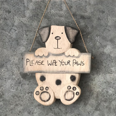 East if India Rustic hanging wooden sign in the shape of a dog holding a plaque saying:  'Please wipe your paws'  Material:  Wooden sign with hanging twine