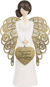 Stunning Angel Figurine which features a hanging heart shaped metal charm, jewel embellishment (in hair and on heart charm) and the sentiment 'The love between Mother and Daughter is forever The figurine comes gift boxed.