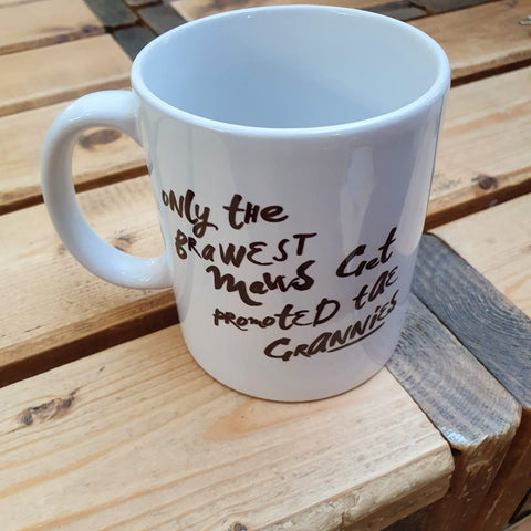 Monochrome mug with the Scottish slang slogan:  'Only the brawest maws get promoted tae Granny'  Printed in Glasgow.