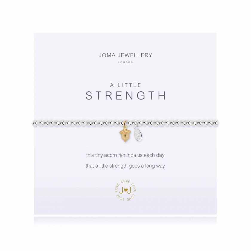 Joma Jewellery 'a little' bracelet with little acorn charm, presented on a sentiment card which reads:  ''this tiny acorn reminds us each day, that a little strength goes a long way""