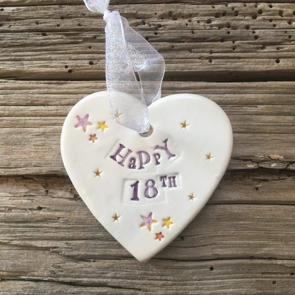 Hand painted ceramic heart featuring star design and the sentiment 'Happy 18th'  Handmade in the UK using clay, glaze and paint sourced locally.  Material:  Ceramic