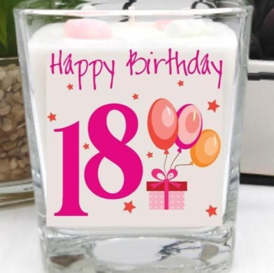 This gorgeous scented square jar candle features the message 'Happy Birthday 18'. Beautifully finished with small wax hearts on top and it comes in its very own gift box.