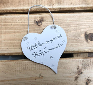 Hanging wooden heart - hand painted pink with the printed slogan:  'With love on your 1st Holy Communion'