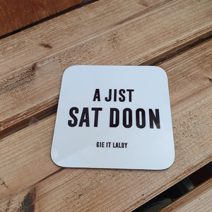 Monochrome Coaster featuring the Scottish slang slogan:  'A Jist Sat Doon'