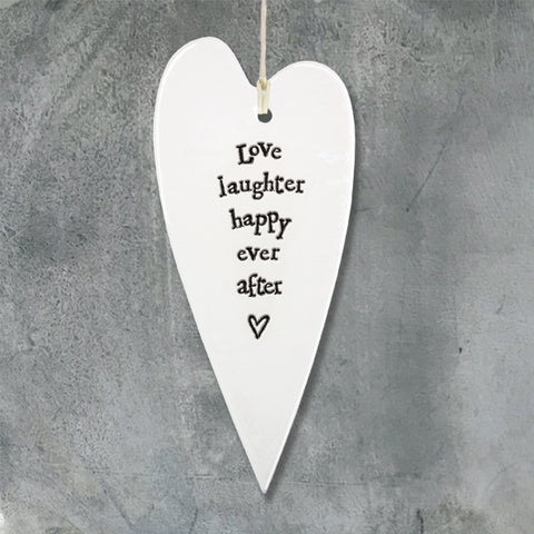 White Hanging Long Porcelain Heart from East of India which reads:  'Love laughter happy ever after'
