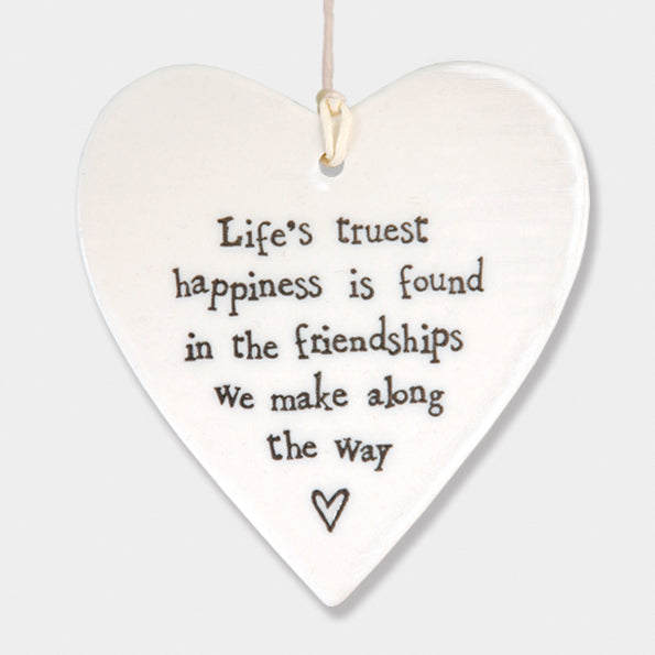 East of India hanging porcelain heart which reads:  'Life's truest happiness is found in the friendships we make along the way'