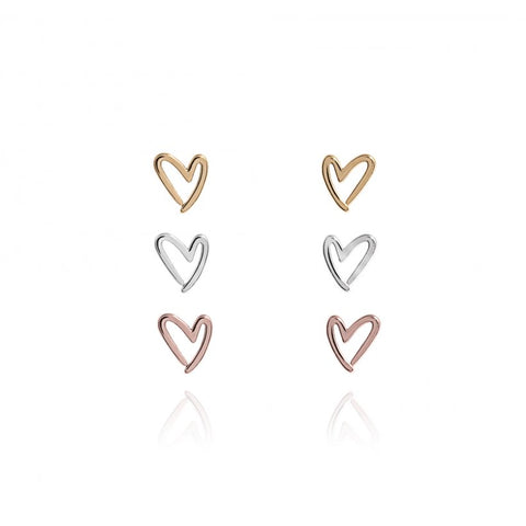 Joma Jewellerys beautiful Florence earring set with pretty rose gold, yellow gold and silver outline heart shape studs, presented on a sentiment card which reads:  'With Love'