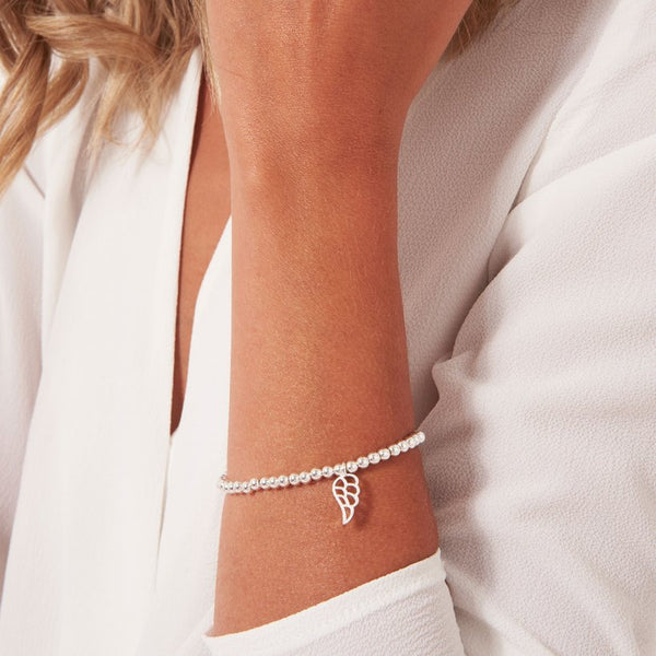 Joma Jewellery sweet sentiments bracelet with a beautiful angel wing charm, presented in a little round box which reads:  'Gaurdian Angel'