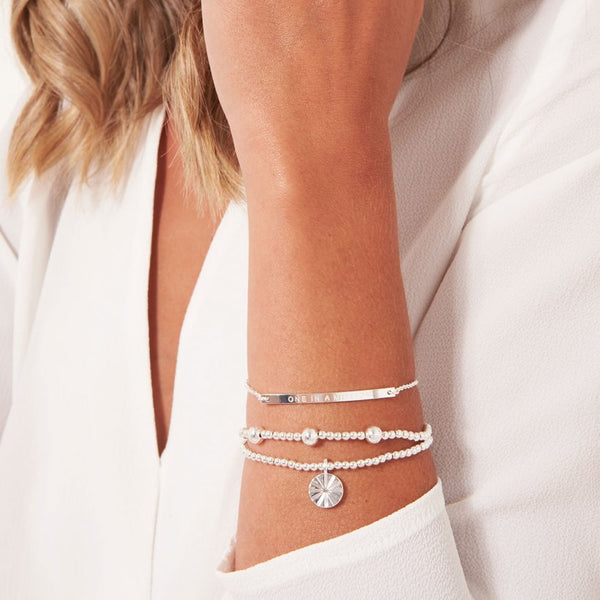 Joma Jewellery Occasion Gift Box containing 3 stunning stacking bracelets, beautifully presented on a soft suedette pillow.  The sentiment on the inside of the box and also on adjustable bracelet reads:  'One in a million'