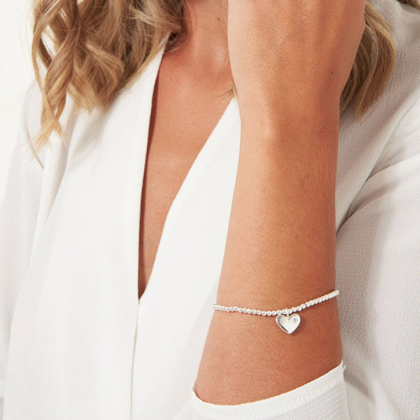 Joma Jewellery 'a little' faceted bracelet with beautiful heart charm with sparkly gemstone, presented on a sentiment card which reads:  'wear this little bracelet every day because you're a beautiful bride in every way'