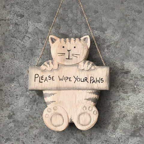 Rustic hanging wooden sign in the shape of a cat holding a plaque saying:  'Please wipe your paws'