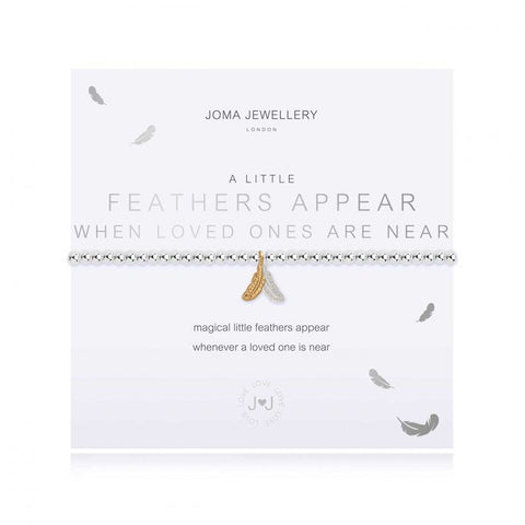 Joma Jewellery 'a little' bracelet with pretty silver and gold feather charms, presented on a sentiment card which reads:  'magical little feathers appear whenever a loved one is near'