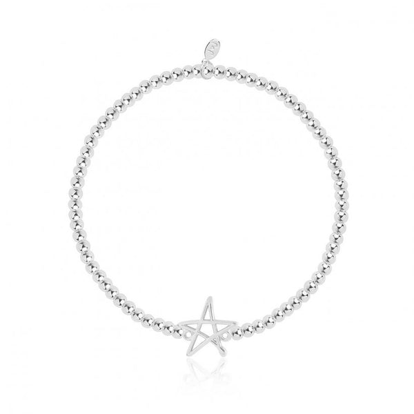 Joma Jewellery bracelet with pretty silver star charm, presented on a sentiment card which reads:  'A little festive treat for a fabulous friend!'