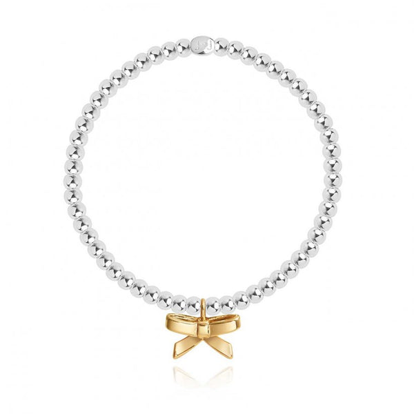 Joma Jewellery sweet sentiments bracelet with a beautiful golden bow charm, presented in a little round box which reads:  'Birthday Girl'  This 'A Little'   treasured bracelet will shine forever!