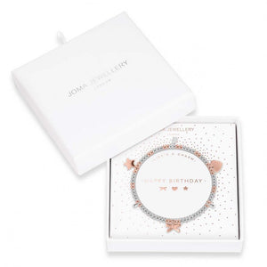 Joma Jewellery bracelet scattered with precious little keepsake charms, including shining heart, a glowing star and a cute little bow charm.   Beautifully packaged in it's own little box which reads 'Happy Birthday'