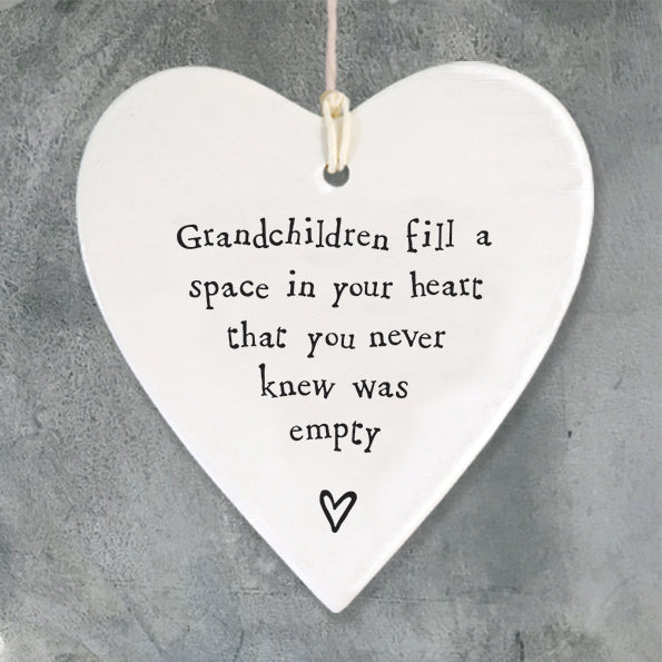 East of India hanging porcelain heart which reads:  'Grandchildren fill a space in your heart that you never knew was empty'