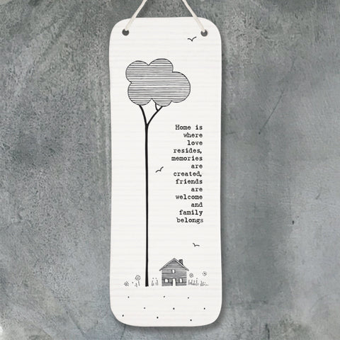 White Long Hanging Porcelain Picture from East of India which reads:  'Home is where love resides, memories are created, friends are welcome and family belongs'