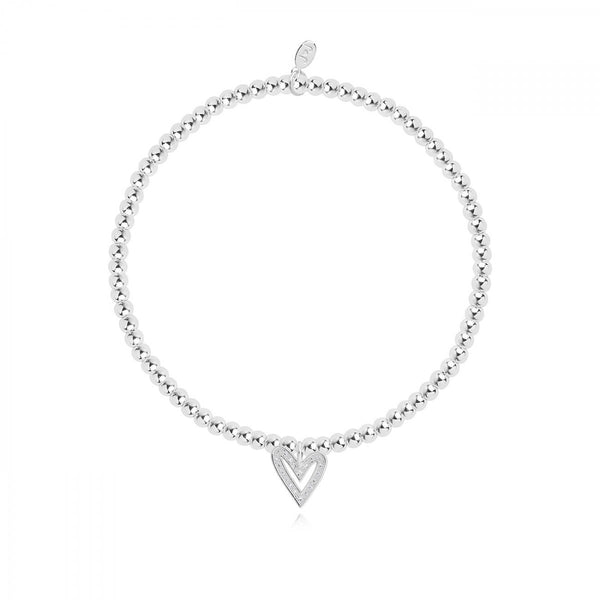 This sweet, sparkling stretch bracelet from Joma Jewellery's 'Confetti A Littles' range is a beautiful gift idea for someone special.  The silver plated bracelet features a sparkly heart charm and comes presented on a card with the sentiment:  'A Little'  'With Love'  'this little bracelet is yours to treasure, someone who will be loved forever'