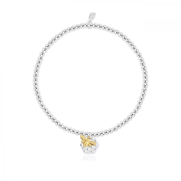 Cute, sparkly silver plated stretch bracelet from Joma Jewellery's 'a little' range.  The pretty bracelet features a gold plated little bee with honeycomb charm and comes presented on a sentiment card which reads:  'A Little'  'You're The Bee's Knees'  'this little charm is just to say you're the bee's knees in every way'