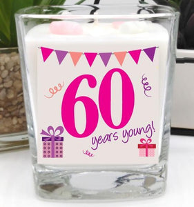 This gorgeous scented square jar candle features the message '60 years young'. Beautifully finished with small wax hearts on top and it comes in its very own gift box.