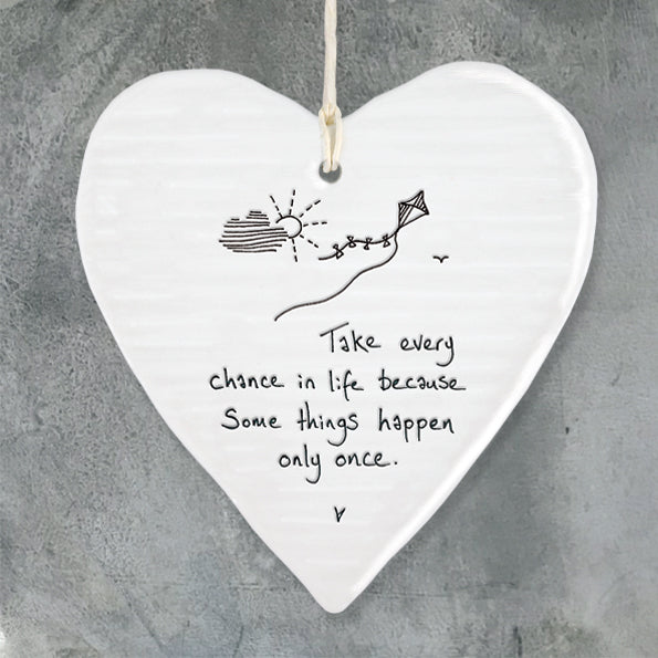 White Hanging Porcelain 'Wobbly' Heart from East of India which reads:  'Take every chance in life because some things happen only once'
