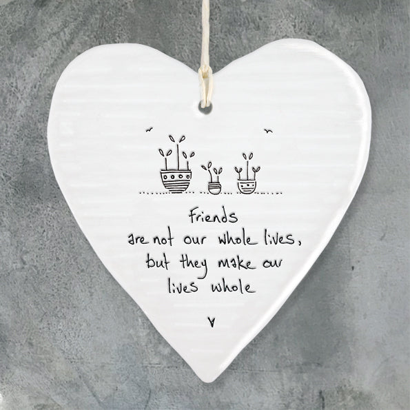 White Hanging Porcelain 'Wobbly' Heart from East of India which reads:  'Friends are not our whole lives, but they make our lives whole'  The heart features an engraved illustration in East of India's unique style.