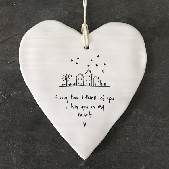 White Hanging Porcelain 'Wobbly' Round Heart from East of India which reads:  'Every time I think of you, I hug you in my heart.'  The heart features an engraved illustration in East of India's unique style.