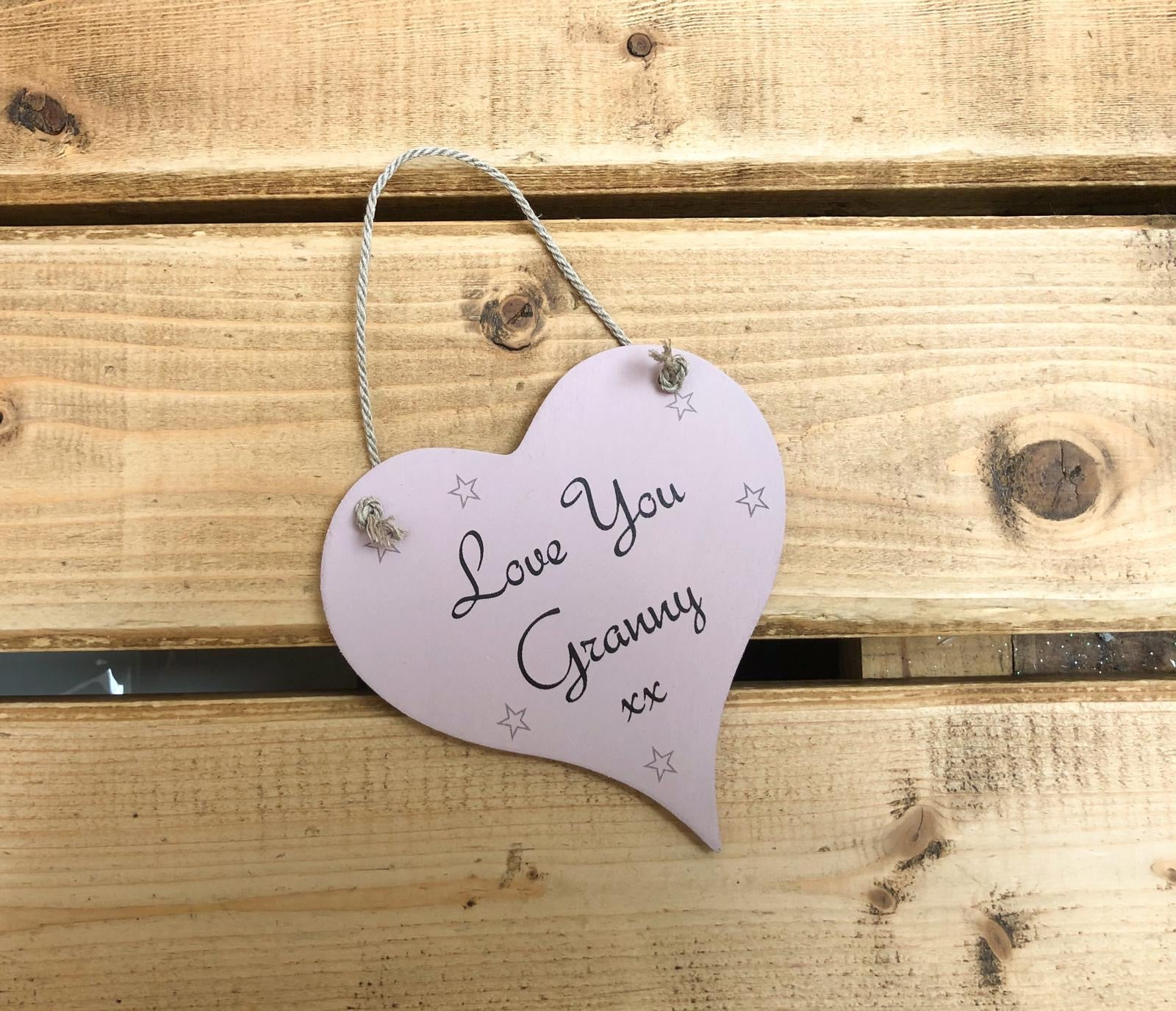 Hanging wooden heart - hand painted with the printed sentiment:  'Love you Granny'  Handmade in the UK