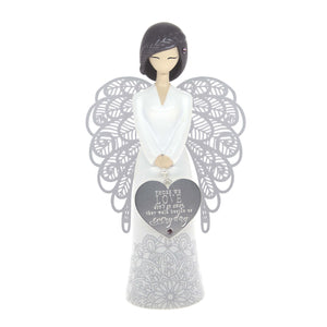 Stunning Angel Figurine which features a hanging heart shaped metal charm. jewel embellishment (in hair and on heart charm) and the sentiment 'Those we love don't go away, they walk beside us every day' The figurine comes gift boxed.