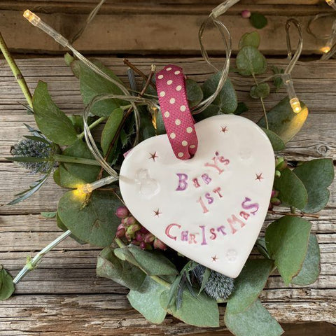 Hand painted ceramic heart featuring a star design and the sentiment 'Baby's 1st Christmas'  Handmade in the UK using clay, glaze and paint sourced locally.  Material:  Ceramic