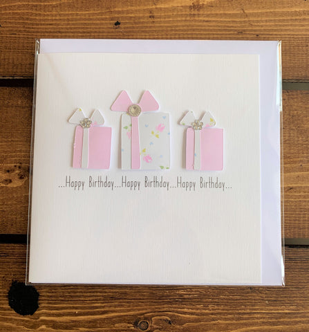 Hand finished birthday card featuring embellished presents design which reads:  'Happy Birthday ... Happy Birthday...Happy Birthday...'