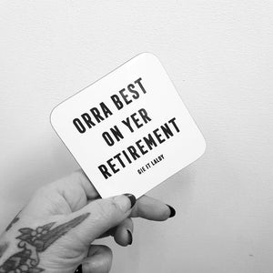 Monochrome Coaster featuring the Scottish slang slogan:  'Orra Best On Yer Retirement'